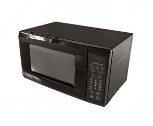 Small black common microwave oven isolated on white.
